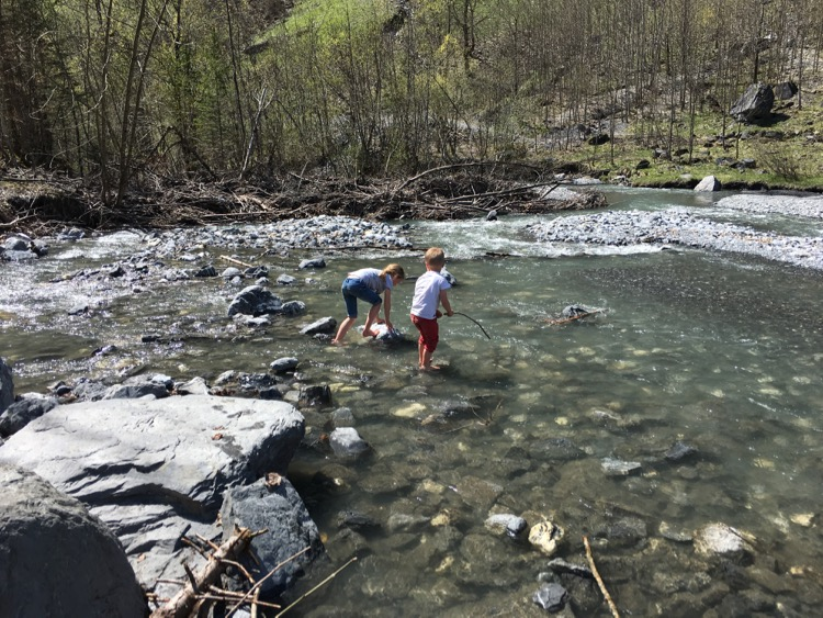 The kids playing in the river at Cirque du Fer-a-Cheval.