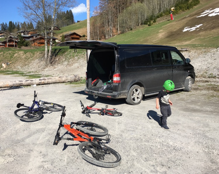 VW transporter and mountain bikes in the Perrieres car Park Les Gets during inter-season