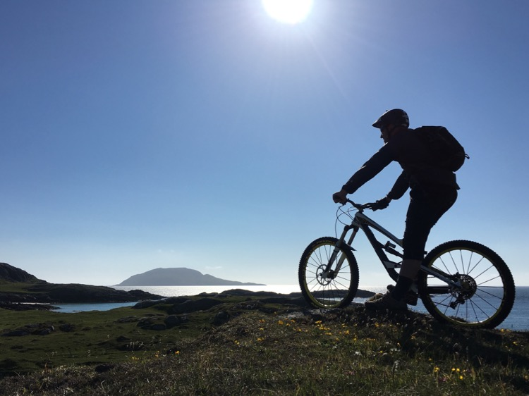 Mountain biker silhouette on Vatersay