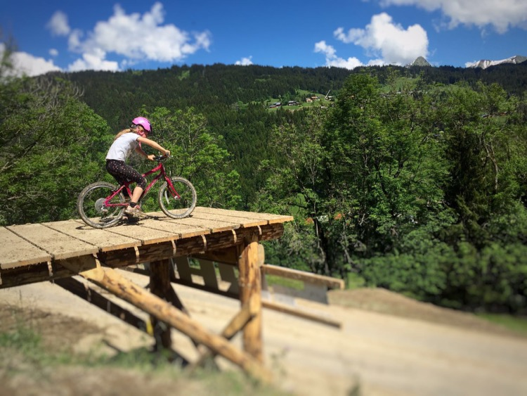 Iz hitting one of the Crankworx road gaps. I told you she was getting good ;)