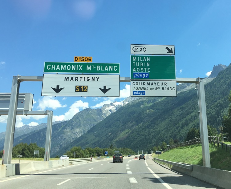 Road sign for the Mont Blanc tunnel and Italy turn off.