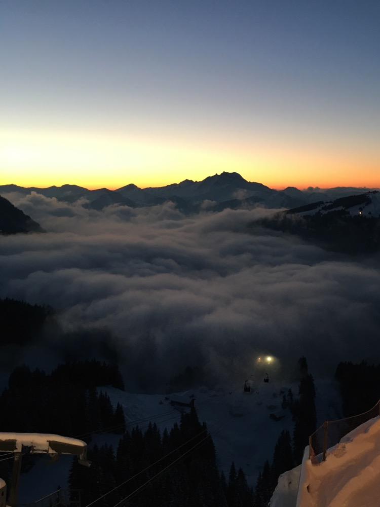 Sunset behind Roc D'Enfer and the Prodains cable car disappearing into the cloud inversion above Morzine.