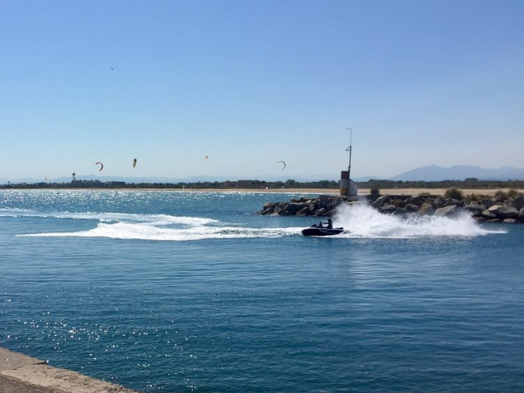 Jet-skis, windsurfers and kite-surfers at Roses, Spain.