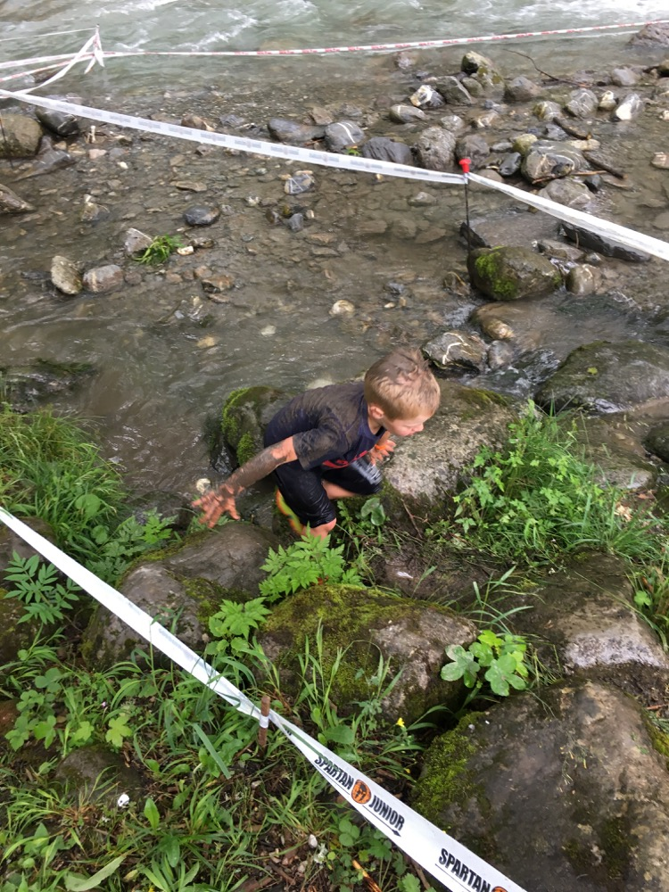 6 year old T exiting the river section of the Spartan Junior 2017 race in Morzine.