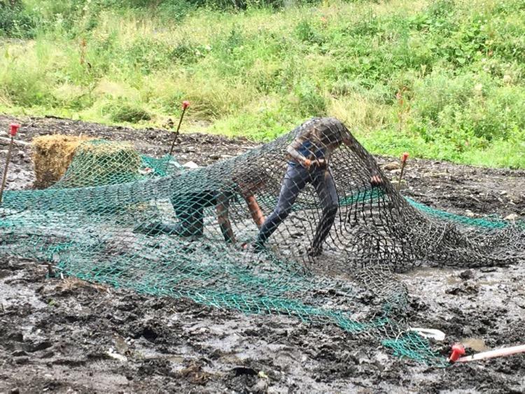 Iz tackling the cargo nets. Morzine Spartan Junior 2017