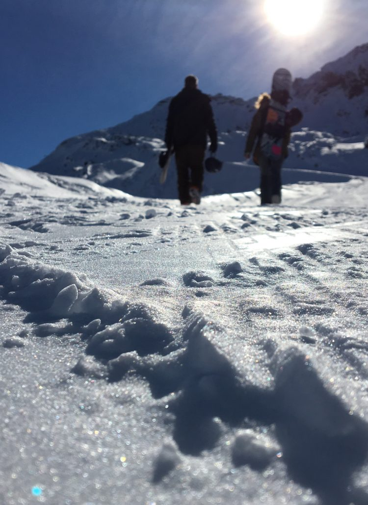 James and Nina hiking Arare in Avoriaz under beautiful blue skies.