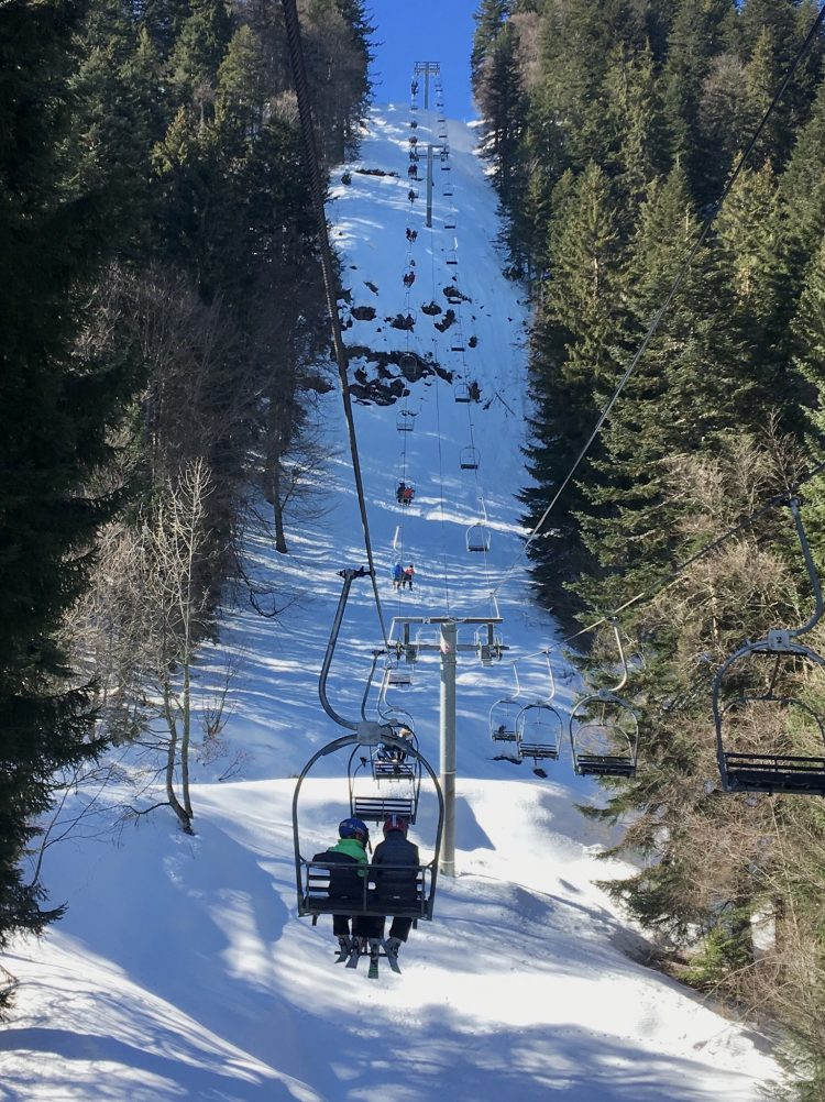 Riding the Planeys chairlift on Mont Chery, Les Gets during the half term ski holidays.