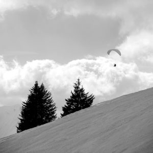 Parapenting on Mont Chèry, Les Gets black and white photograph up-Stix