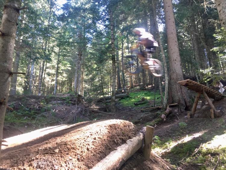 Jacko sending the 'boner log' on a black trail at Bernex bike park.