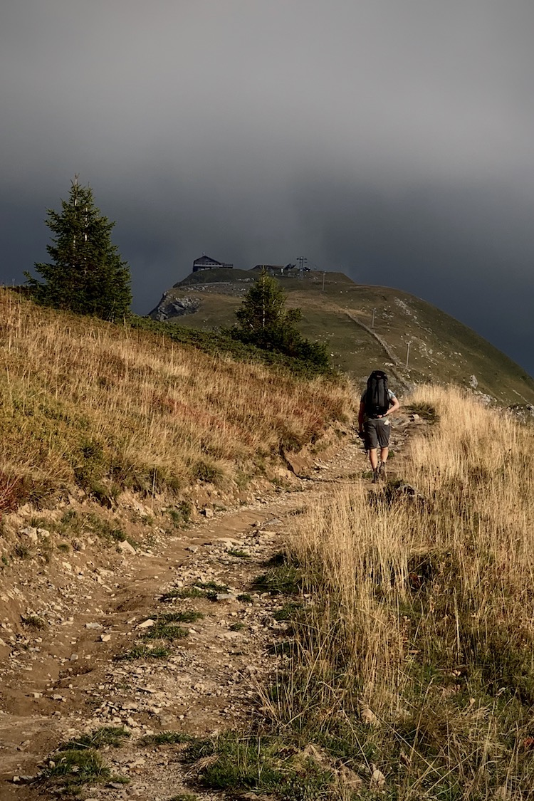 Hiking the trails towards our camping date with some very dark clouds ahead at the Cookie Cafe and pointe de mossettes!