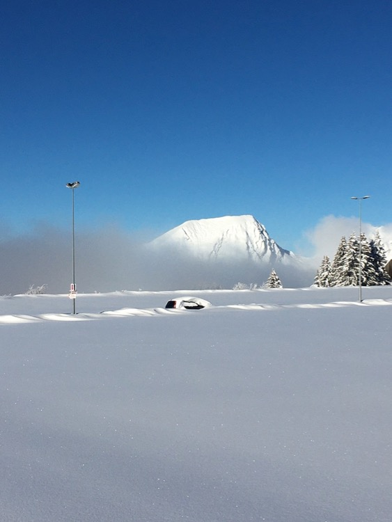 UpStix Images Buried car in a car park covered in deep snow on a blue sky day in Avoriaz, Portes du Soleil